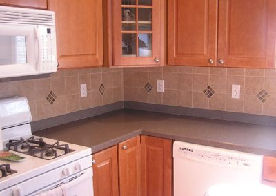 Porcelain Tile Backsplash with Slate Insets in Hudson, Ohio