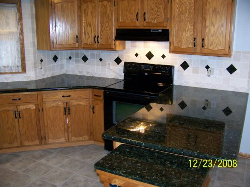 Natural Stone Backsplash with Granite Insets in Hudson, Ohio