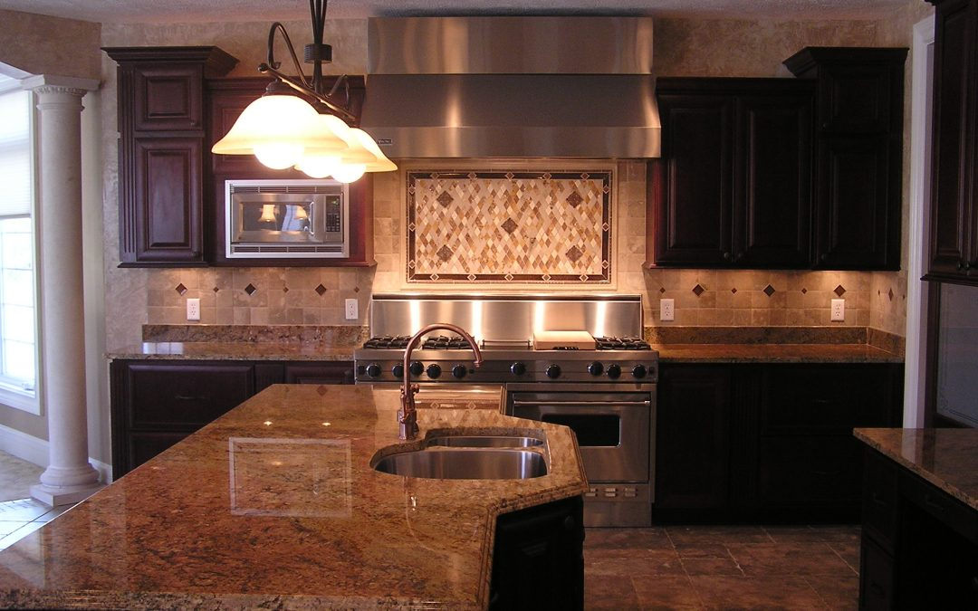 Custom Stone Backsplash with Crackled Glass Insets in Cuyahoga Falls, Ohio