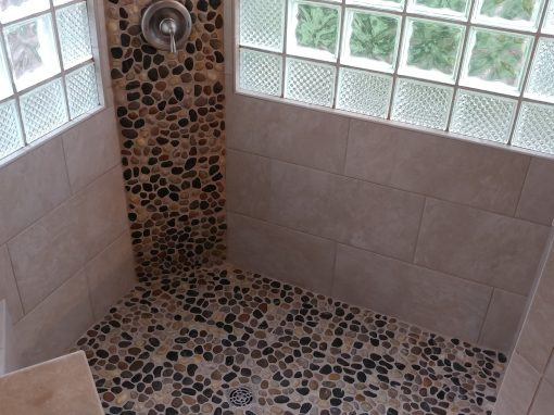 Porcelain Tile Shower with Pebble Stone Floors in Mayfield Heights, Ohio